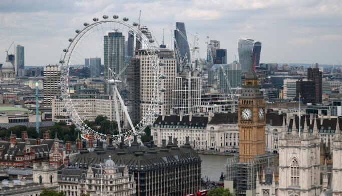 FILE PHOTO: The London Eye, the Big Ben clock tower and the City of London financial district are seen from the Broadway development site in central London, Britain, August 23, 2017. Picture taken August 23, 2017. REUTERS/Hannah McKay/File Photo