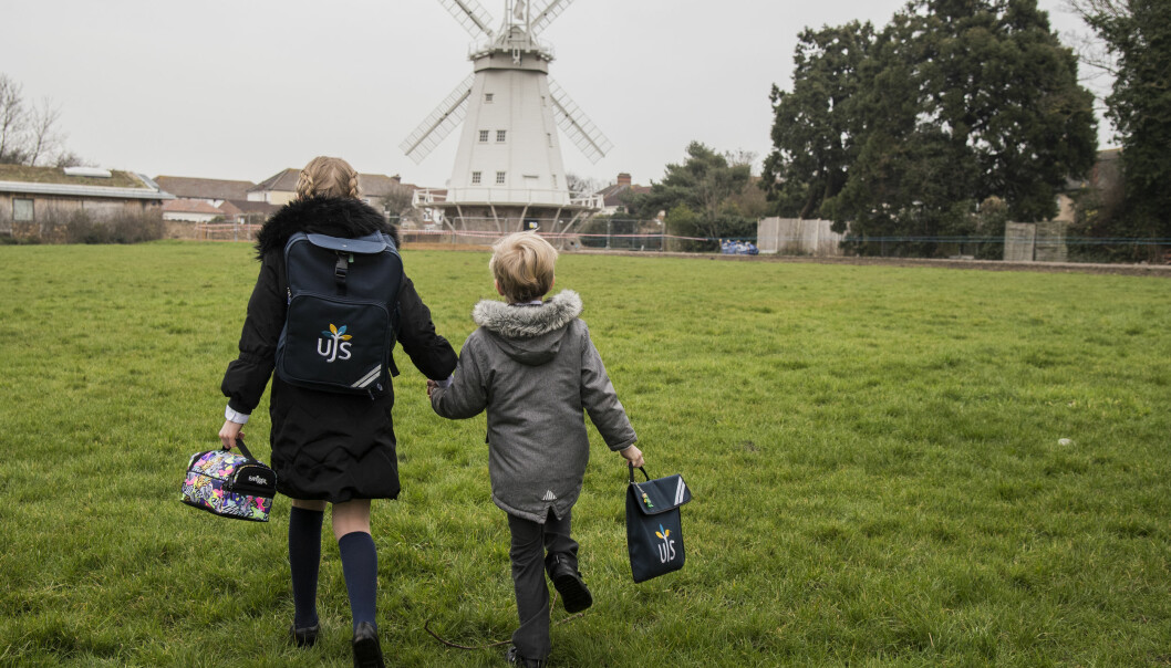 Children on their way to the Upminster Junior School in Essex, as pupils in England return to school for the first time in two months as part of the first stage of lockdown easing. Picture date: Monday March 8, 2021.