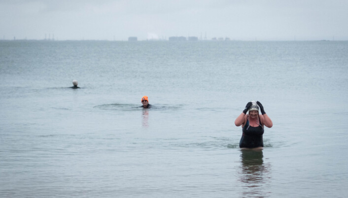 Swimmers at Leigh-on-Sea in Essex. Picture date: Thursday March 18, 2021.