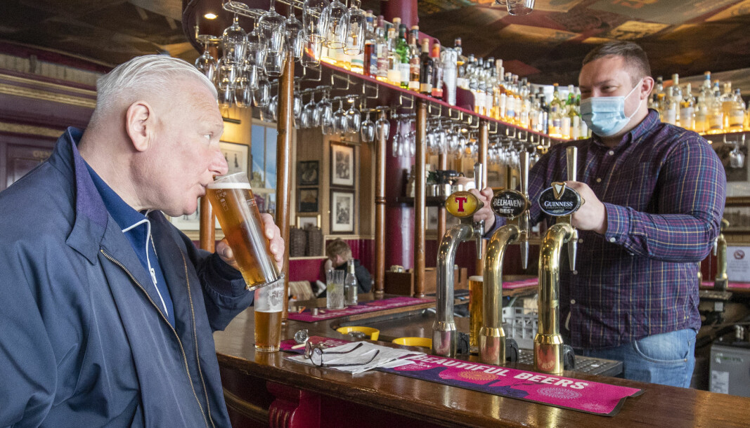 Customers in the Waverley, Edinburgh, enjoy a drink inside the bar, as Scotland eases out of lockdown.