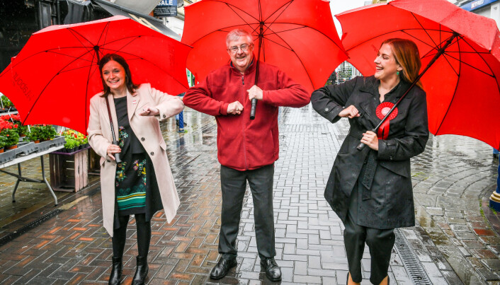 Wales First Minister Mark Drakeford elbow bumps newly elected MS Labour candidates Elizabeth Buffy Williams, Rhondda, left, and Sarah Murphy, Bridgend & Porthcawl, right, as they meet in Porthcawl, Wales. Picture date: Saturday May 8, 2021.