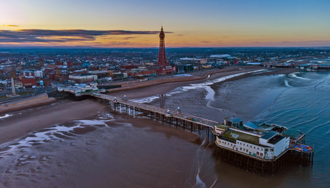 The sun rises behind the Blackpool Tower in Blackpool, Lancashire. Picture date: Friday April 2, 2021.
