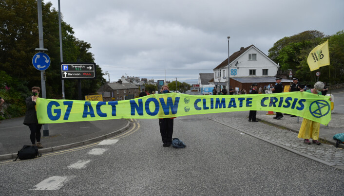 Protesters holding a banner on an XR Protest from St Ives Leisure Centre to St Ives, during the G7 summit in Cornwall.