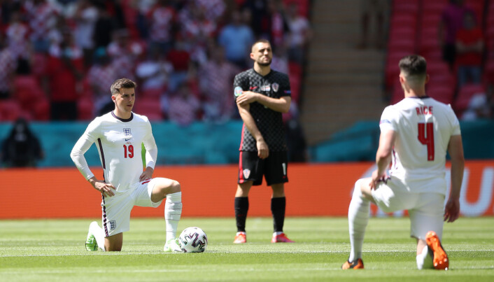 England's Mason Mount and Declan Rice take the knee before their Euro 2020 match at Wembley