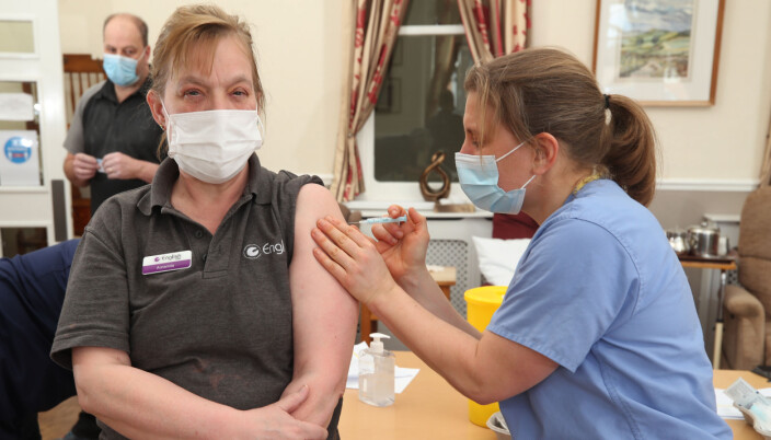 Dr Jess Harvey administers the second dose of Oxford/AstraZeneca coronavirus vaccine to care home assistant Amanda Lucas at the Lady Forester Community nursing home in Much Wenlock, Shropshire. Picture date: Thursday March 25, 2021.
