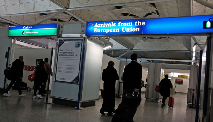 Passengers arriving back to the UK pass through customs and immigration at Stansted airport, London.