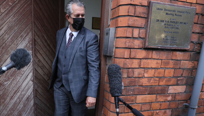 Edwin Poots leaves the DUP headquarters in Belfast after he said he will stand down as the party leader following an internal party revolt against him.