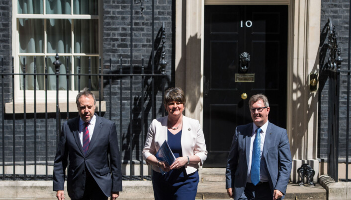 DUP leader Arlene Foster, DUP deputy leader Nigel Dodds (left) and MP Sir Jeffrey Donaldson leave 10 Downing Street in London after the party agreed a deal to support the minority Conservative government.