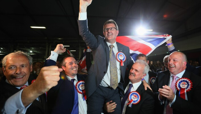 DUP candidate for Lagan Valley Jeffrey Donaldson celebrates following his election at the Eikon Exhibition Centre in Lisburn as counting is under way for the General Election.