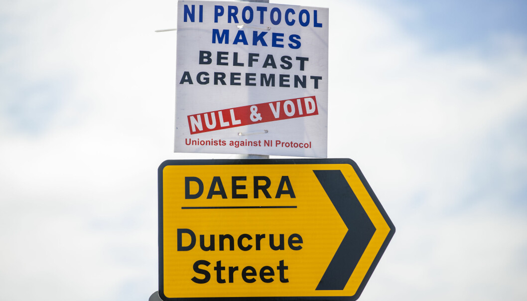 Anti NI Protocol sign above a sign for the Northern Ireland Department of Agriculture, Environment and Rural Affairs (DAERA) site on Duncrue Street in Belfast, which is one of the sites used when lorries roll off the ferries that is used to perform checks. Picture date: Monday June 28 2021.
