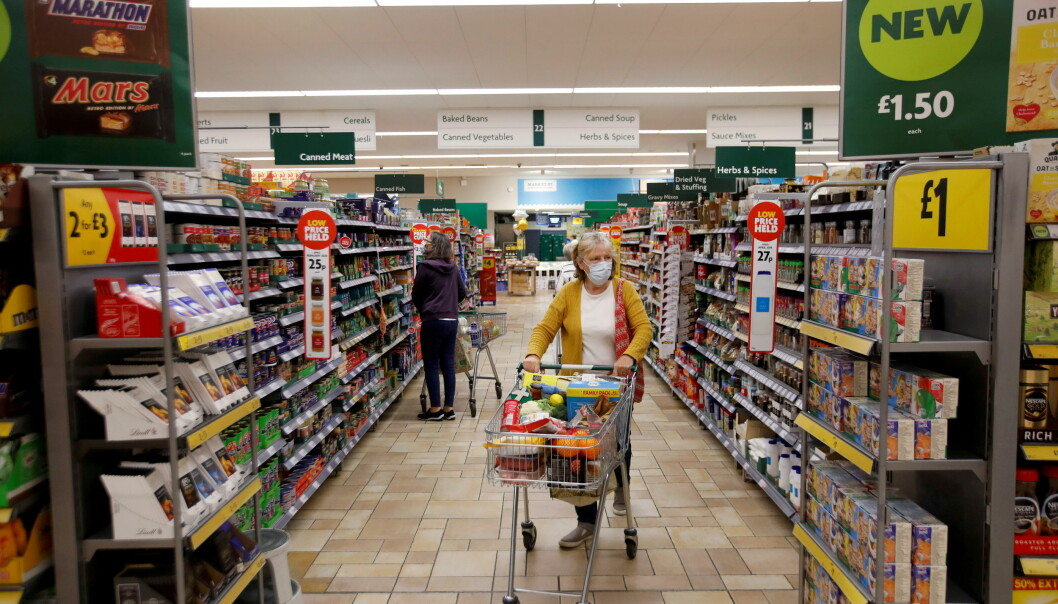 A customer wearing a protective face mask shops at a Morrisons store in St Albans