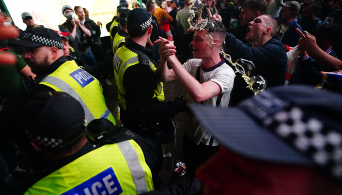 England fans clash with police in Piccadilly Circus, London, after Italy beat England on penalties to win the UEFA Euro 2020 Final