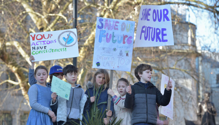 Children with placards during a climate change protest on Parliament Square in Westminster.