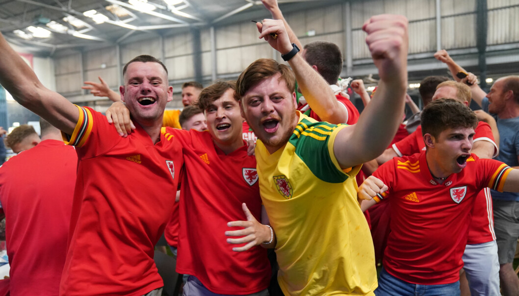 Wales fans celebrate a goal at the Wales Fanzone at Vale Sport Arena, Cardiff as they watch the UEFA Euro 2020 Group A match between Wales and Switzerland held at the Baku Olympic Stadium, Azerbaijan. Picture date: Saturday June 12, 2021.