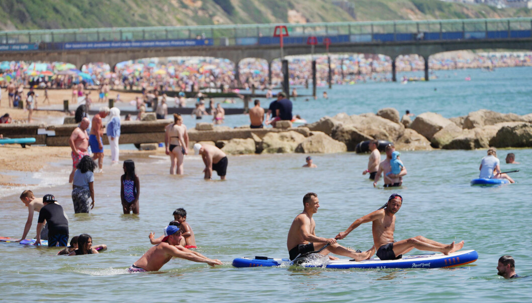 People enjoy the weather on Bournemouth beach in Dorset. England could see the hottest day of the year this weekend as the skies finally clear after weeks of wet and humid weather. Picture date: Saturday July 17, 2021.