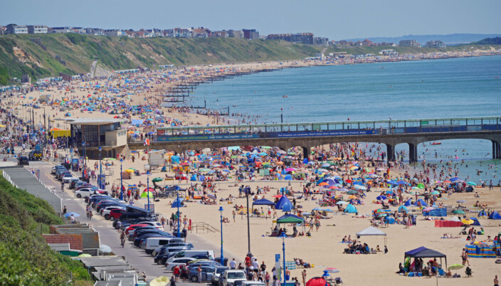 People enjoy the weather on Bournemouth beach in Dorset.