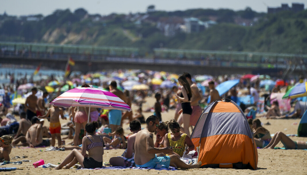 People enjoy the weather on Bournemouth beach in Dorset. Picture date: Monday July 19, 2021.
