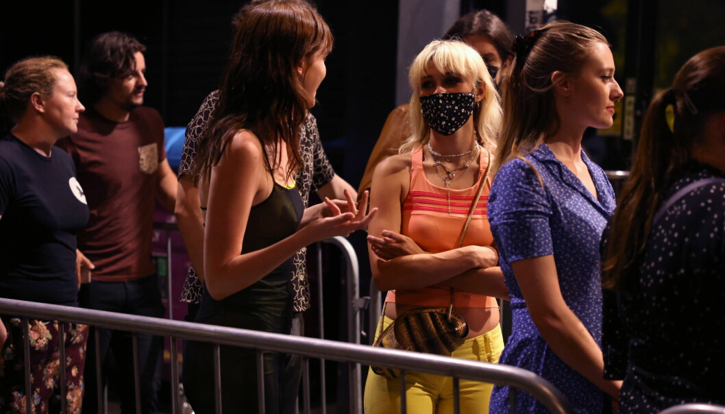 """People arrive for the """"00:01"""" event organised by Egyptian Elbows at Oval Space nightclub, as England lifted most coronavirus disease (COVID-19) restrictions at midnight, in London, Britain, early July 19, 2021. REUTERS/Natalie Thomas"""