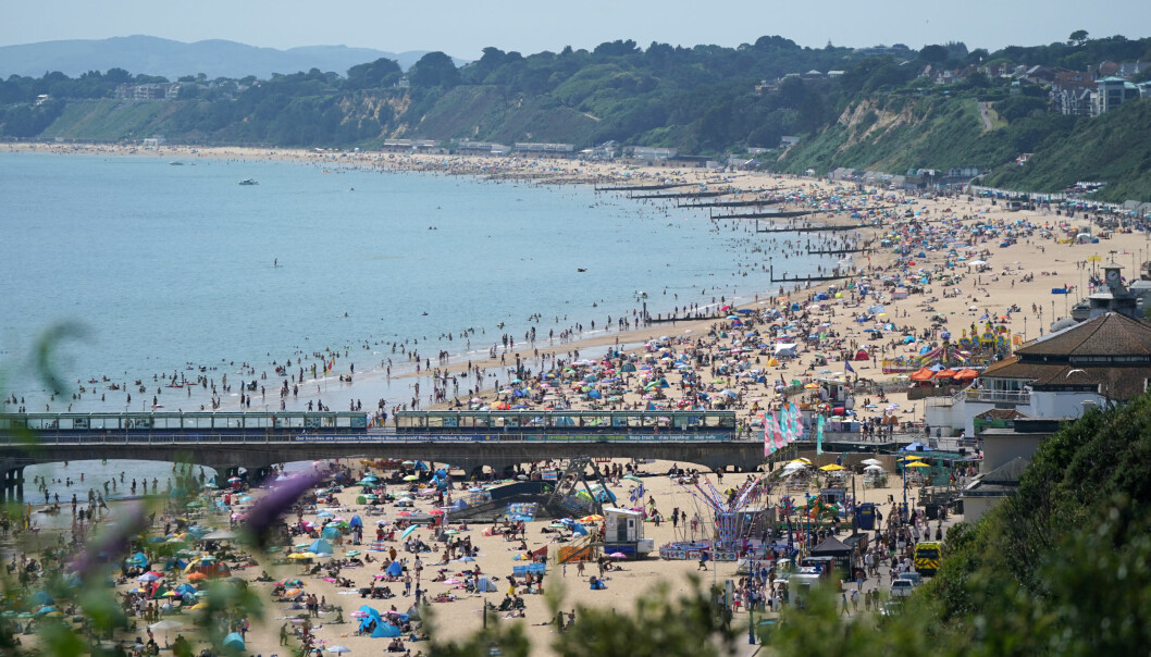 People enjoying the hot weather at Bournemouth Beach in Dorset.