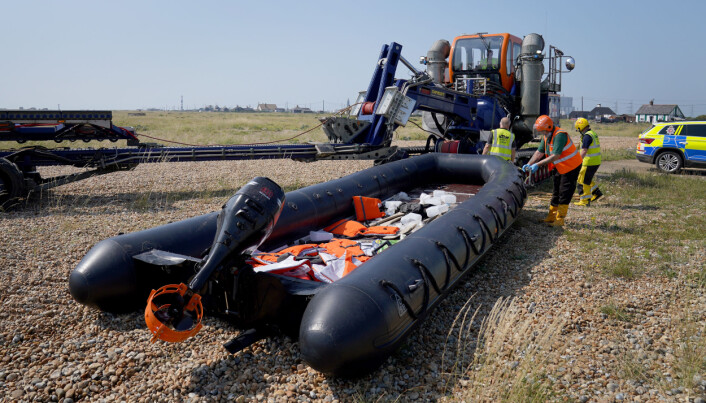 A boat used by a group of people thought to have been migrants crossing from France is towed from the beach at Dungeness, Kent, following a small boat incident in the Channel. Picture date: Tuesday July 20, 2021.