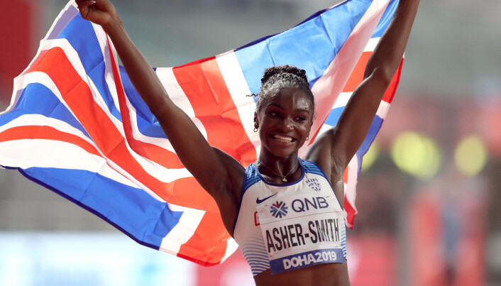 Great Britain's Dina Asher-Smith celebrates winning the Women's 200m final during day six of the IAAF World Championships at The Khalifa International Stadium, Doha, Qatar. Issue date: Friday July 9, 2021.