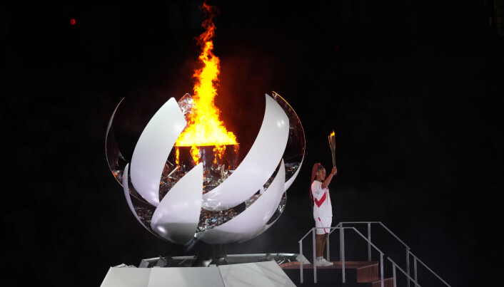 Naomi Osaka lights the Olympic flame during the opening ceremony of the Tokyo 2020 Olympic Games.