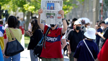 A newspaper is held up in protest outside the Olympic Stadium.