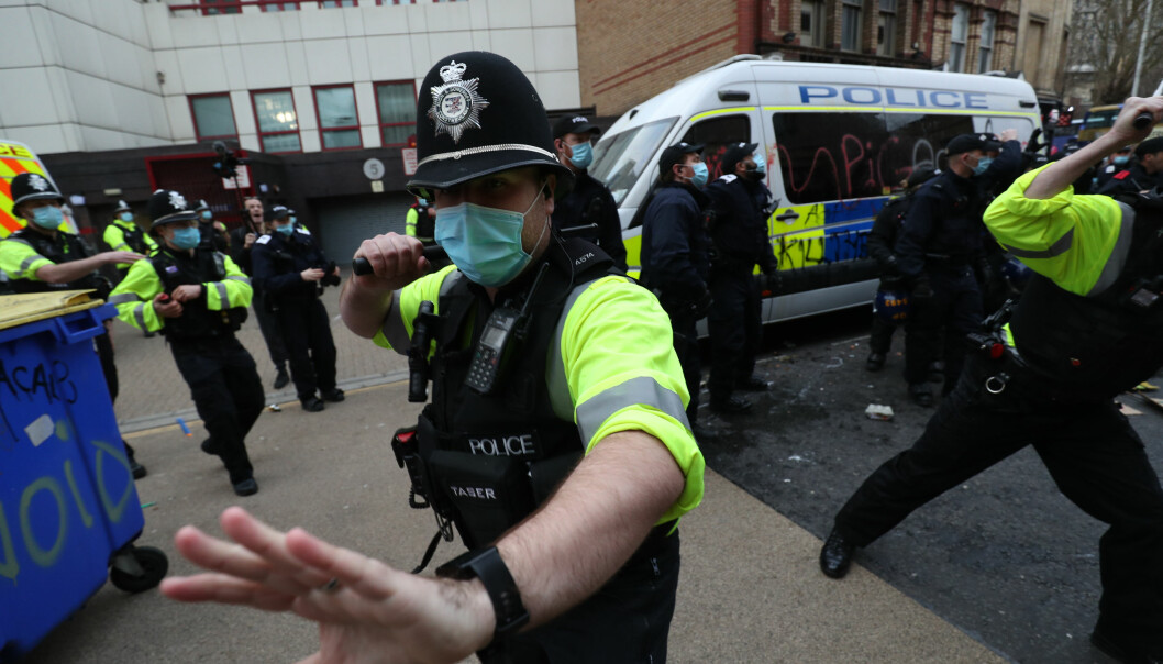Police holding back people outside Bridewell Police Station as they take part in a 'Kill the Bill' protest in Bristol, demonstrating against the Government's controversial Police and Crime Bill.