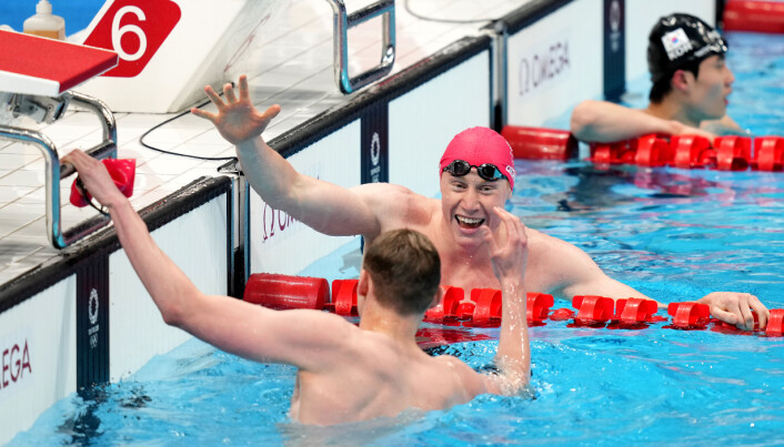 Great Britain's Tom Dean (centre) celebrates winning the Men's 200m Freestyle with Great Britain's Duncan Scott at Tokyo Aquatics Centre on the fourth day of the Tokyo 2020 Olympic Games in Japan. Picture date: Tuesday July 27, 2021.