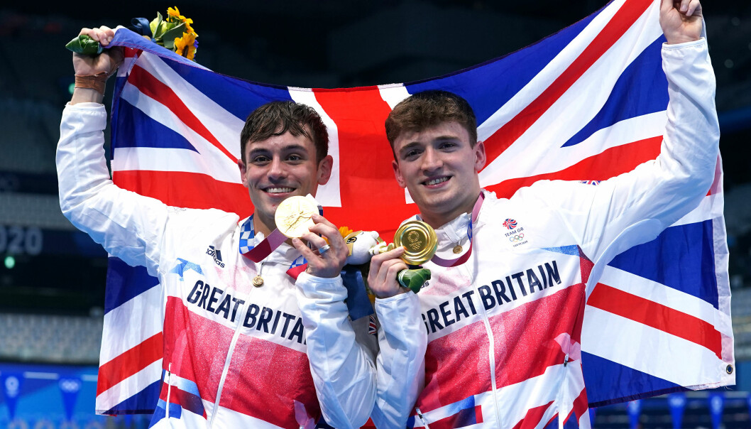 Great Britain's Tom Daley (left) and Matty Lee celebrate winning gold in the Men's Synchronised 10m Platform Final at the Tokyo Aquatics Centre on the third day of the Tokyo 2020 Olympic Games in Japan.