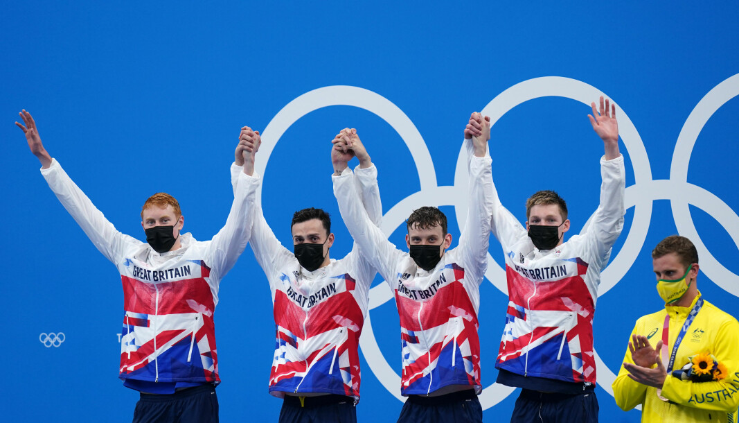 Great Britain's Tom Dean, James Guy, Matthew Richards and Duncan Scott celebrate gold in the Men's 4x200 freestyle relay at Tokyo Aquatics Centre on the fifth day of the Tokyo 2020 Olympic Games.