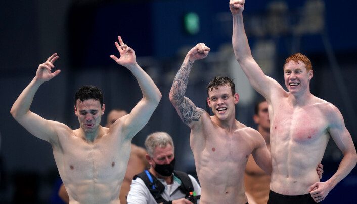 Great Britain's James Guy, Matthew Richards and Tom Dean celebrate gold in the Men's 4x200 freestyle relay at Tokyo Aquatics Centre.