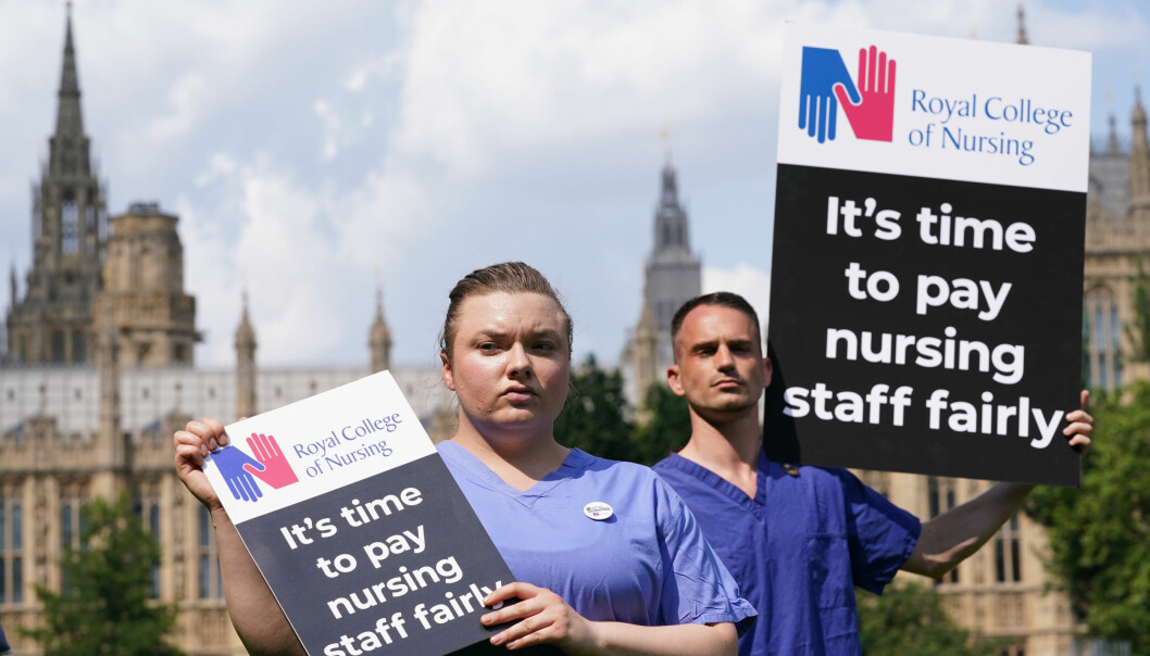 Nurses with placards outside the Royal College of Nursing (RCN) in London.