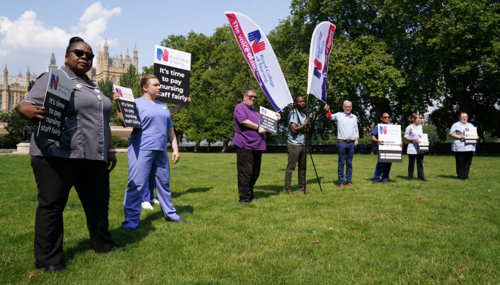 Nurses with placards outside the Royal College of Nursing (RCN) in Victoria Tower Gardens, London.