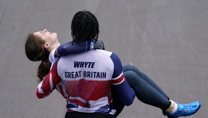 Great Britain's Silver medalist Kye Whyte helps carry Bethany Shriever after she wins Gold in the Cycling BMX Racing at the Ariake Urban Sports Park on the seventh day of the Tokyo 2020 Olympic Games in Japan. Picture date: Friday July 30, 2021.