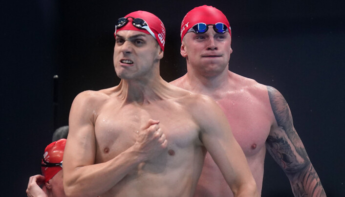 Great Britain's Adam Peaty and James Guy celebrate winning the Mixed 4100 metres medley relay during the swimming at the Tokyo Aquatics Centre on the eighth day of the Tokyo 2020 Olympic Games in Japan. Picture date: Saturday July 31, 2021.