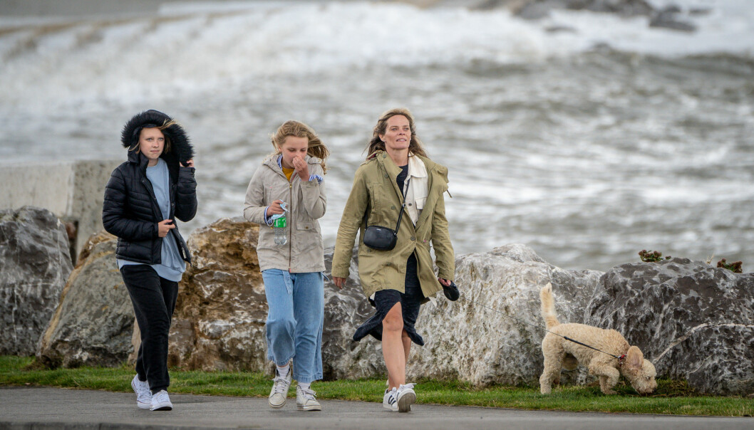 """People walk their dog along the sea front in Porthcawl, Wales, after winds of up to 75mph lashed parts of the South West as Storm Evert hit the UK on Thursday and Friday. The Met Office said the newly named storm will bring """"unseasonably strong winds and heavy rain"""". Picture date: Friday July 30, 2021."""