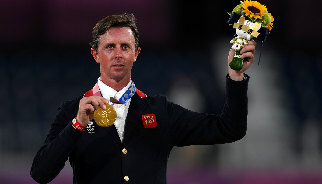 Great Britain's Ben Maher with his Gold medal after riding Explosion W during the Jumping Individual Final at Equestrian Park on the twelfth day of the Tokyo 2020 Olympic Games in Japan. Picture date: Wednesday August 4, 2021.