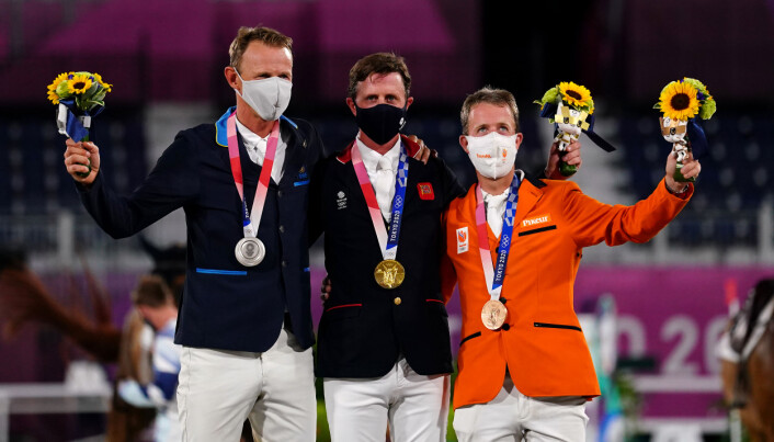 Medalists Great Britain's Ben Maher (Gold), Swedens Peder Fredricson (Silver) and Netherlands Maikel van der Vleuten (Bronze) after the Jumping Individual Final at Equestrian Park on the twelfth day of the Tokyo 2020 Olympic Games in Japan. Picture date: Wednesday August 4, 2021.