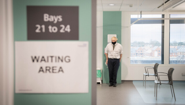 Prime Minister Boris Johnson in the waiting area of Chase Farm Hospital in north London.
