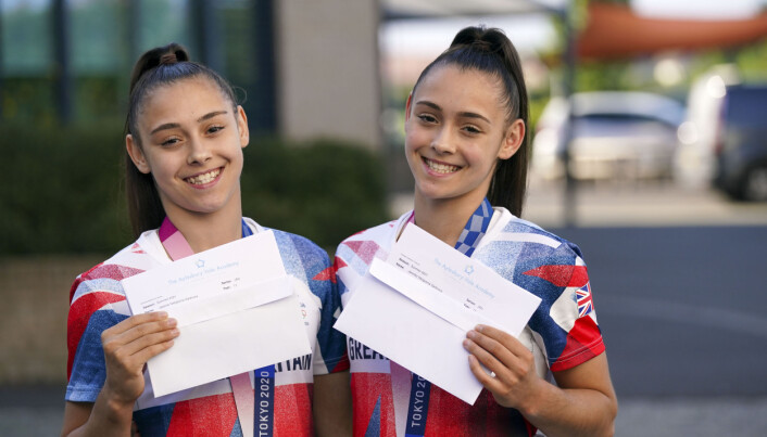 Olympic medal winning twins Jessica (left) and Jennifer Gadirova celebrate their GCSE results at Aylesbury Vale Academy in Buckinghamshire. Picture date: Thursday August 12, 2021.
