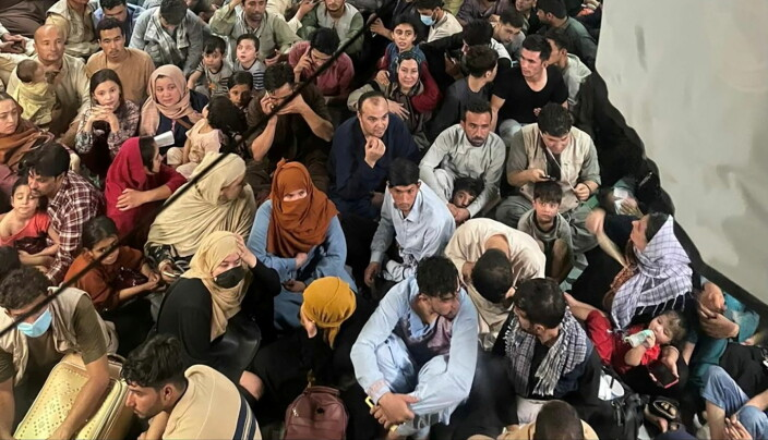 Evacuees crowd the interior of a U.S. Air Force C-17 Globemaster III transport aircraft, carrying some 640 Afghans to Qatar from Kabul, Afghanistan August 15, 2021. Picture taken August 15, 2021.