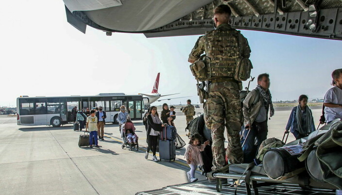 British citizens and dual nationals residing in Afghanistan board a military plane for evacuation from Kabul airport, Afghanistan August 16, 2021.