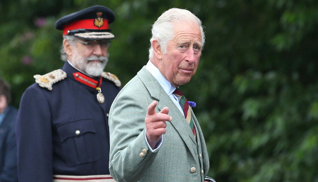 Britain's Prince Charles gestures during a visit to DS McGregor and Partners Veterinary Surgery in Thurso, Caithness
