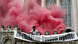 Extinction Rebellion protesters spray red paint after scaling Guildhall entrance