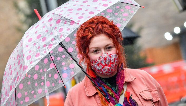A woman wearing a face mask in the centre of Cardiff.