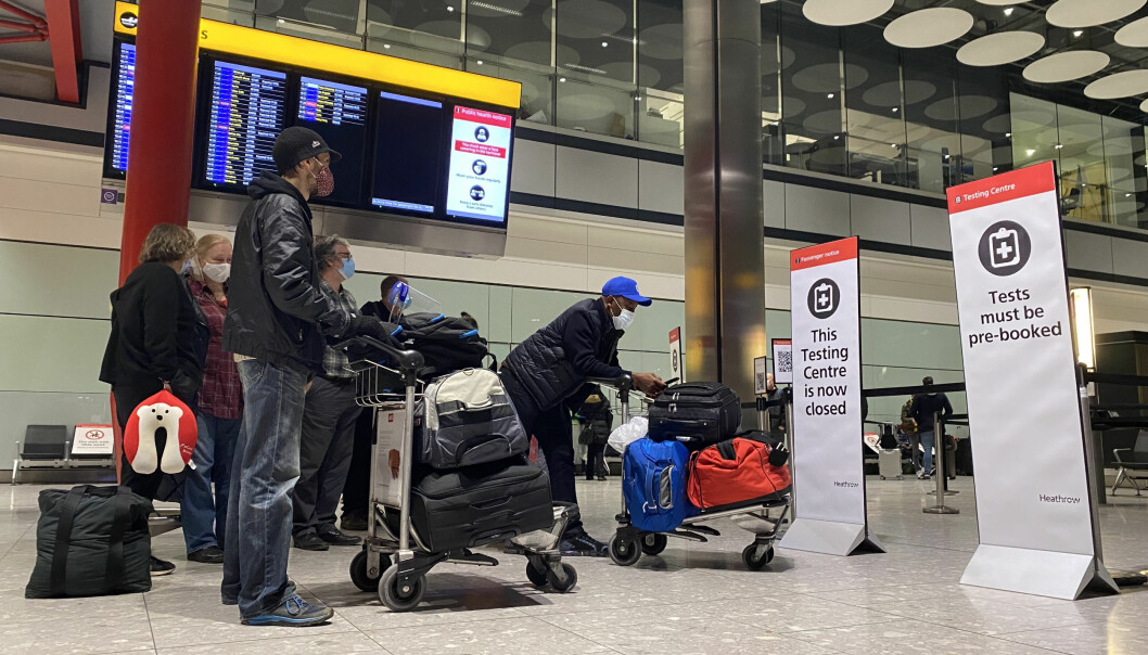 Passengers waiting in line outside the Testing Centre in the Arrival Hall of Terminal 5 at London's Heathrow Airport.