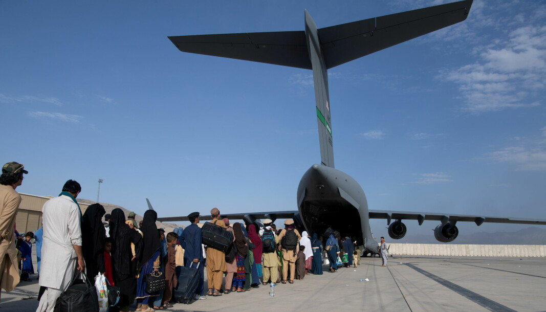 US Air Force loadmasters and pilots assigned to the 816th Expeditionary Airlift Squadron, load passengers aboard a U.S. Air Force C-17 Globemaster III in support of the Afghanistan evacuation at Hamid Karzai International Airport in Kabul, Afghanistan.