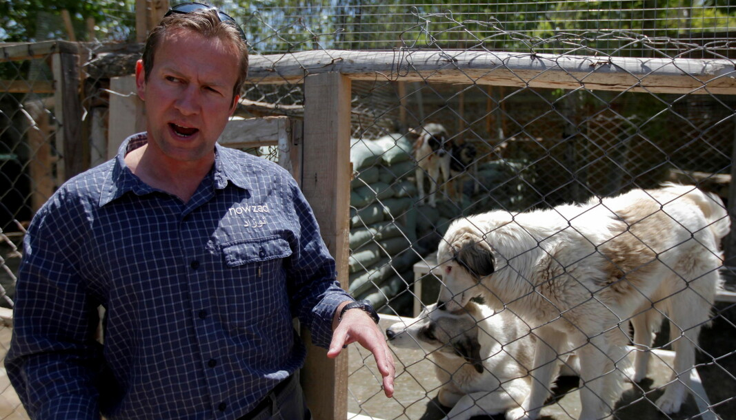 Pen Farthing, founder of British charity Nowzad, an animal shelter, stands in front of a cage on the outskirts of Kabul, 2012.