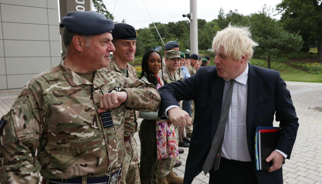 Prime Minister Boris Johnson is greeted by military personnel as he arrives for a visit to Northwood Headquarters, the British Armed Forces Permanent Joint Headquarters, in Eastbury, north west London